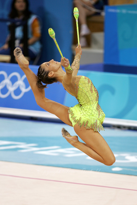 Almudena Cid of Spain stag leaps with clubs at 2004 Athens Olympic Games during qualifications on August 27, 2006 at Athens, Greece. (Photo by Tom Theobald)