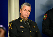 Sheriff Michael A. Lewis of Wicomico County, Maryland, listens as acting Director, United States Immigration and Customs Enforcement (ICE) Matthew Albence briefs reporters in the Brady Briefing Room of the White House in Washington, DC on Thursday, October 10, 2019.<br /> Credit: Ron Sachs / CNP