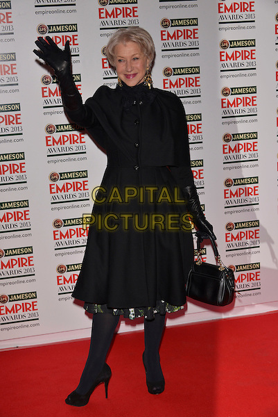 Dame Helen Mirren.The 18th Jameson Empire Film Awards at Grosvenor House, London, England..March 24th, 2013.full length black coat jacket gloves tights hand arm in air waving bag purse .CAP/PL.©Phil Loftus/Capital Pictures.