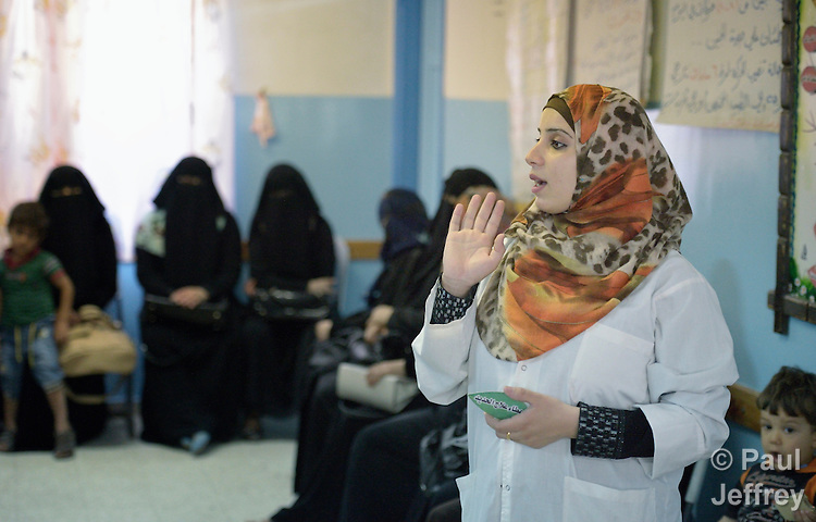 Amani El Assar, a nurse and patient educator, talks with a group of women waiting to be seen in the prenatal section of a clinic in Shejaiya, a neighborhood of Gaza City that was hard hit by the Israeli military during the 2014 war. The clinic is run by the Department of Service for Palestinian Refugees of the Near East Council of Churches, a member of the ACT Alliance, and funded in part by the Pontifical Mission for Palestine.  This clinic has twice been destroyed by Israeli air strikes, but each time has been rebuilt by DSPR.