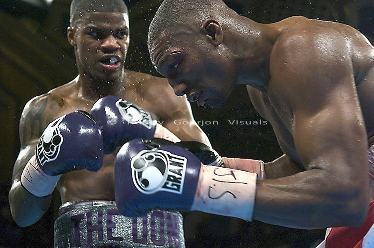 Jaidon Codrington (L) on the offensive against Levan Easley during their New York State Super Middleweight Title 10 round fight at the Hammerstein Ballroom in Manhattan, New York, on August 04, 2005..Codrington won the belt by 5th round TKO.