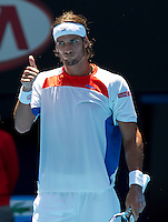 FELICIANO LOPEZ (ESP) against RAFAEL NADAL (ESP) in the fourth round of the Men's Singles. Rafael Nadal beat Feliciano Lopez 6-4 6-4 6-2..22/01/2012, 22nd January 2012, 22.01.2012 - Day 7..The Australian Open, Melbourne Park, Melbourne,Victoria, Australia.@AMN IMAGES, Frey, Advantage Media Network, 30, Cleveland Street, London, W1T 4JD .Tel - +44 208 947 0100..email - mfrey@advantagemedianet.com..www.amnimages.photoshelter.com.