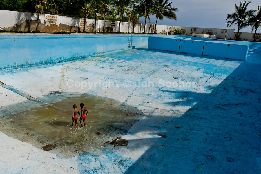 Cuban kids play a game in the bottom of the old drained swimming pool in a small costal village of Siboney, Cuba, August 3, 2008. About 50 years after the national rebellion, led by Fidel Castro, and adopting the communist ideology shortly after the victory, the Caribbean island of Cuba is the only country in Americas having the communist political system. Although the Cuban state-controlled economy has never been developed enough to allow Cubans living in social conditions similar to the US or to Europe, mostly middle-age and older Cubans still support the Castro Brothers' regime and the idea of the Cuban Revolution. Since the 1990s Cuba struggles with chronic economic crisis and mainly young Cubans call for the economic changes.