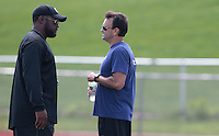 HEMPFIELD TOWNSHIP, PA - AUGUST 20:  Pittsburgh Steelers head coach Mike Tomlin talks with agent Drew Rosenhaus following Terrell Pryor's pro day at a practice facility on August 20, 2011 in Hempfield Township, Pennsylvania.  (Photo by Jared Wickerham/Getty Images)