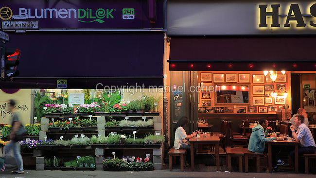 Flower shop and restaurant in the evening, Oranienstrasse, Berlin, Germany. Picture by Manuel Cohen