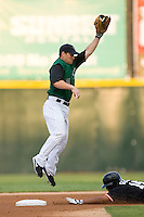 Second baseman Keith Ginter #11 of the Charlotte Knights goes up high to catch a throw as Freddy Guzman #14 of the Norfolk Tides steals second base at Knights Stadium August 14, 2009 in Fort Mill, South Carolina. (Photo by Brian Westerholt / Four Seam Images)