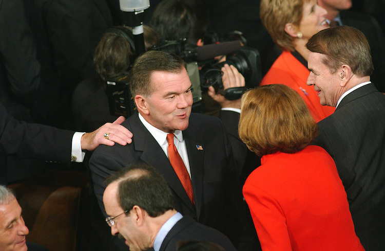 1/28/03.STATE OF THE UNION ADDRESS--Homeland Security Director Tom Ridge is greeted by members as he enters the House chamber for President George W. Bush's State of the Union address at the U.S. Capitol..CONGRESSIONAL QUARTERLY PHOTO BY SCOTT J. FERRELL