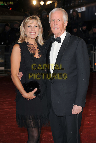"""GUEST & MICHAEL APTED.The Royal Film Performance 2010: The World Premiere of """"Chronicles of Narnia: The Voyage of the Dawn Treader"""" at the Odeon, Leicester Square, London, England..November 30th 2010.half length black sleeveless dress tuxedo lace clutch bag .CAP/BEL.©Tom Belcher/Capital Pictures."""