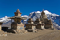 A series of CHORTENS near the second NAR GATE and KANGGURU PEAK at 6981 meters - NAR PHU TREK, ANNAPURNA CONSERVATION AREA, NEPAL