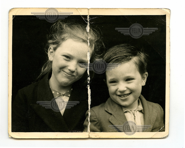 A photographs from Tommy's family album: 'Me and my big sister Rose. She never let me down. Now she is in a home. The drink beat her. Love you big sis.'.