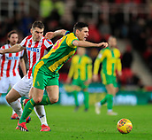9th February 2019, bet365 Stadium, Stoke-on-Trent, England; EFL Championship football, Stoke City versus West Bromwich Albion; Gareth Barry of West Bromwich Albion is tripped by Sam Vokes of Stoke City