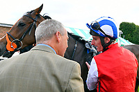 Jockey of Star in the Making briefs Trainer Clive Cox in the Winner's enclosure after winning The Simpson Hilder Associates Supporting Gift Of Sight EBF Fillies' Novice Stakes during Evening Racing at Salisbury Racecourse on 3rd September 2019