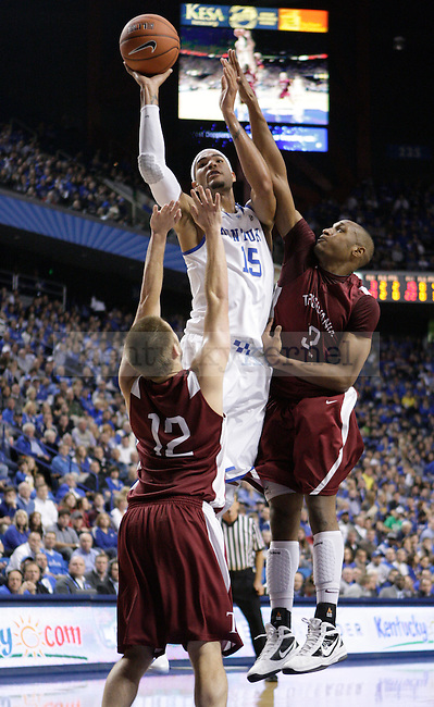 UK forward Willie Cauley-Stein (15) jumps to shoot the ball between Transy defenders Taylor Botkin (12) and Brandon Rash (32) during the first half of the UK men's basketball game vs. Transylvania University at Rupp Arena in Lexington, Ky., on Monday, November 5, 2012. Photo by Tessa Lighty | Staff