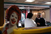 Claremont, New Hampshire.USA.January 26, 2004..General Wesley Clark campaigns fo the democratic presidency by visiting a McDonalds and greeting the clients.