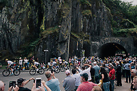 the peloton exiting the tunnel at the foot of the 3rd cat climb; the Côte d'Eschdorf (2.3km @ 9.3%)<br /> <br /> 104th Tour de France 2017<br /> Stage 3 - Verviers › Longwy (202km)