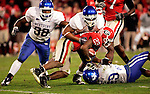 UK players tackle Georgia wide receiver Prince Miller during the third quarter of UK's game against the Georgia Bulldogs on Saturday, Nov. 21, 2009 at Sanford Stadium in Athens, Ga. The Cats defeated the Bulldogs 34-27.
