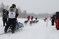 Carole Keller of Eagle River leaves the start line of the 2009 Junior Iditarod on Knik Lake on Saturday Februrary 28, 2009.