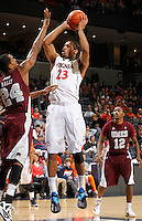 CHARLOTTESVILLE, VA- December 27: Mike Scott #23 of the Virginia Cavaliers shoots over Hillary Haley #24 of the Maryland-Eastern Shore Hawks during the game on December 27, 2011 at the John Paul Jones Arena in Charlottesville, Va. Virginia defeated Maryland Eastern Shore 69-42.  (Photo by Andrew Shurtleff/Getty Images) *** Local Caption *** Mike Scott;Hillary Haley