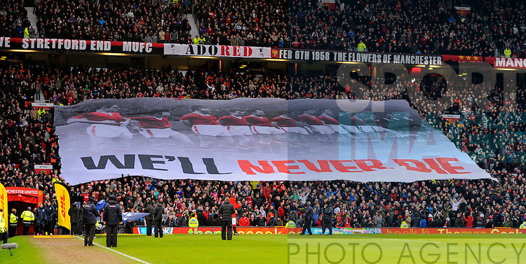 The Stretford End display a banner before the match remembering the Munich air crash - Barclays Premier League - Manchester Utd vs Everton - Old Trafford Stadium - Manchester - 10/02/13 - Picture Simon Bellis/Sportimage
