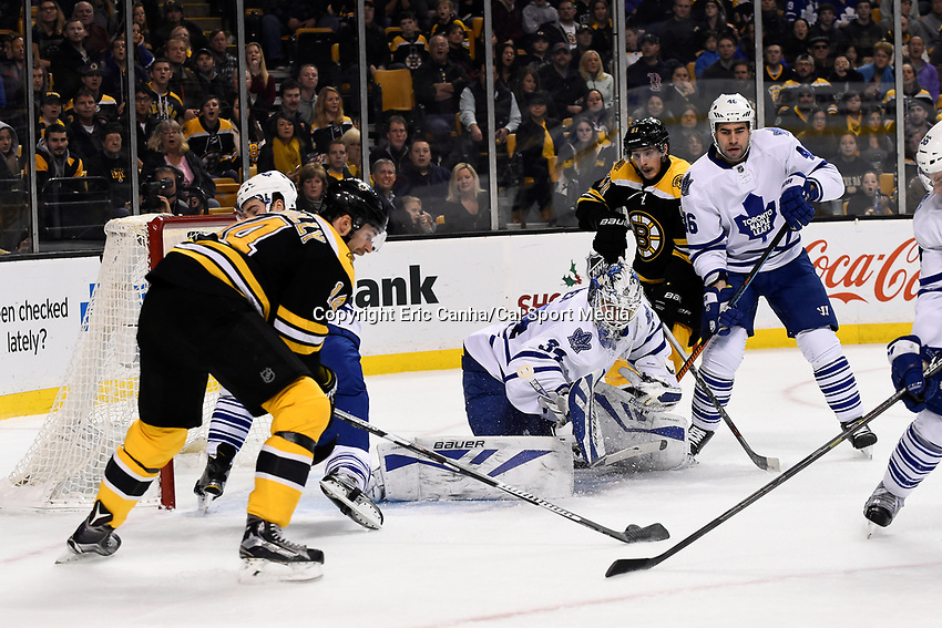 Saturday, November 21, 2015: Toronto Maple Leafs goalie James Reimer (34) watches the puck on Boston Bruins right wing Brett Connolly's (14) stick during the National Hockey League game between the Toronto Maple Leafs and the Boston Bruins held at TD Garden, in Boston, Massachusetts.  Eric Canha/CSM