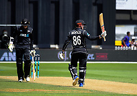 Henry Nicholls celebrates his half century during the One Day International cricket match between the NZ Black Caps and Pakistan at the Basin Reserve in Wellington, New Zealand on Saturday, 6 January 2018. Photo: Dave Lintott / lintottphoto.co.nz