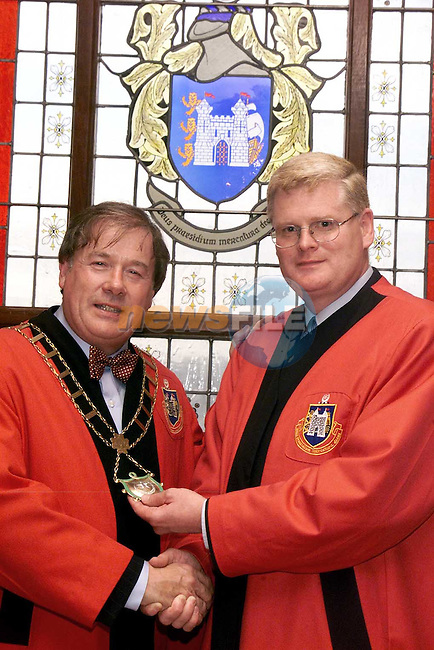Incoming Mayor Cllr. Frank Godfrey being congratulated by newly elected deputy Mayor Cllr. Frank Maher after his election in the corporation chambers on Monday night..Picture Paul Mohan Newsfile