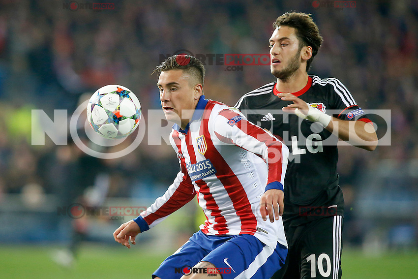 Atletico de Madrid's Jose Maria Gimenez (l) and Bayer 04 Leverkusen's Arda Turan during Champions League 2014/2015 match.March 16,2015. (ALTERPHOTOS/Acero) /NORTEphoto.com