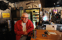 """NWA Democrat-Gazette/ANDY SHUPE<br /> Barry """"Bear"""" Bramlett, owner of Bear's Place on 15th Street in Fayetteville, speaks Thursday, May 25, 2017, at the end of the bar in his bar and restaurant in south Fayetteville that features live music most nights since opening in 2012."""