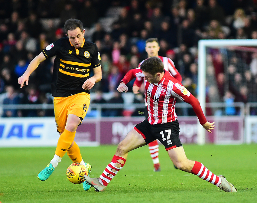Newport County's Matthew Dolan battles with  Lincoln City's Shay McCartan<br /> <br /> Photographer Andrew Vaughan/CameraSport<br /> <br /> The EFL Sky Bet League Two - Lincoln City v Newport County - Saturday 22nd December 201 - Sincil Bank - Lincoln<br /> <br /> World Copyright © 2018 CameraSport. All rights reserved. 43 Linden Ave. Countesthorpe. Leicester. England. LE8 5PG - Tel: +44 (0) 116 277 4147 - admin@camerasport.com - www.camerasport.com