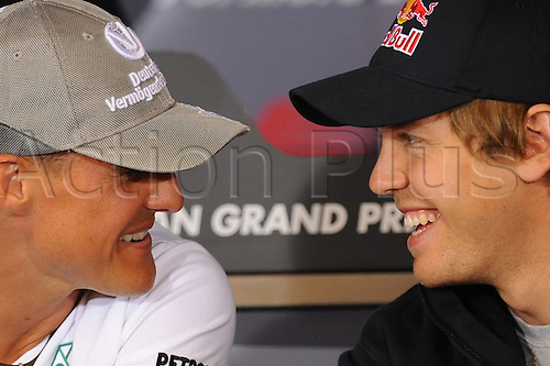 German drivers Michael Schumacher of Mercedes Grand Prix (L) and Sebastian Vettel of Red Bull share a laugh during the official FIA press conference in Spa-Francorchamps, Belgium, 26 August 2010. On 29 August 2010, the Belgian Grand Prix, the 13th race of the Formula One season,