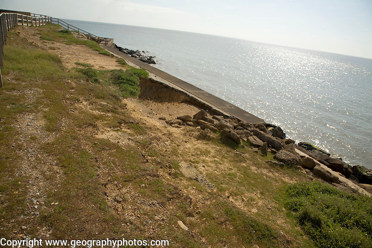 Erosion on top of sea wall caused by backwash scouring and corrasion, East lane, Bawdsey, Suffolk, England