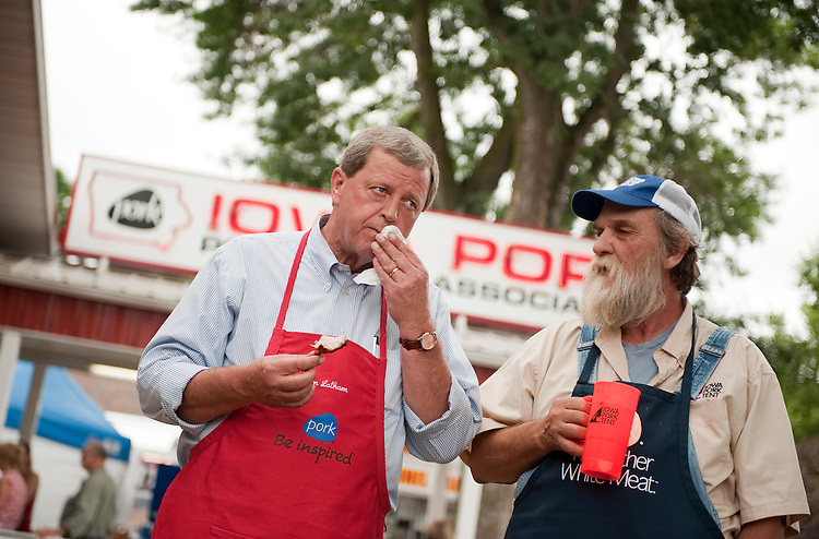 UNITED STATES - AUGUST 16:  Rep. Tom Latham, R-Iowa, left, talks with pork farmer Steve Burgmeier of Lockridge, Iowa, at the Iowa Pork Producers Association pavilion at the Iowa State Fair in Des Moines, Iowa.  (Photo By Tom Williams/Roll Call)