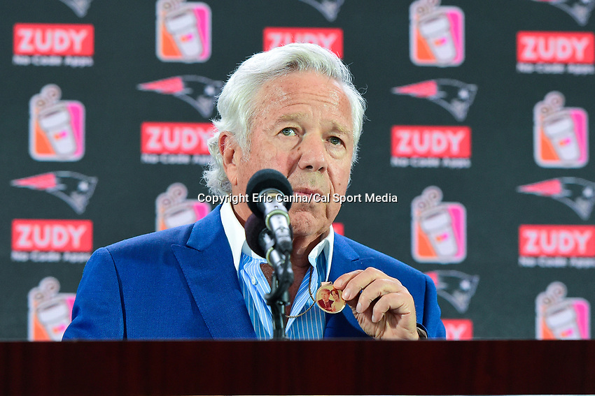 August 9, 2017: Robert Kraft, owner of the New England Patriots speaks at the retirement announcement of Vince Wilfork held at the Optum Field Lounge, in Gillette Stadium, in Foxborough, Mass. Kraft displays a medallion given to him by Wilfork featuring Robert and Myra Kraft on their wedding day.