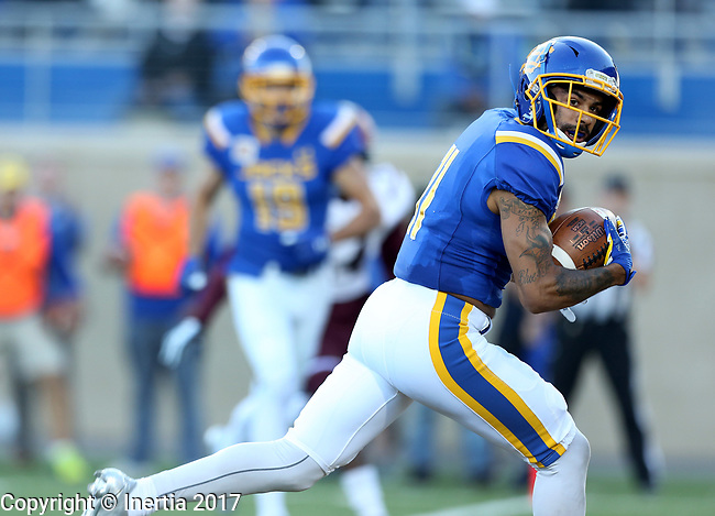 BROOKINGS, SD - OCTOBER 7: Marquise Lewis #11 from South Dakota State University looks for a defender while scampering in for a touchdown against Southern Illinois in the first half of their game Saturday night at Dana J. Dykhouse Stadium in Brookings. (Photo by Dave Eggen/Inertia)