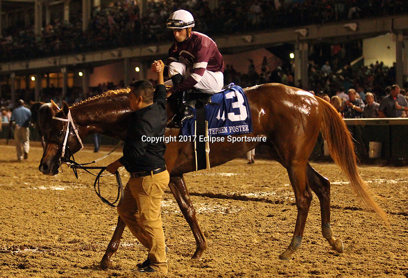 LOUISVILLE, KY - JUNE 17: Gun Runner (#3 Florent Geroux) wins the 36th running of the G1 Stephen Foster Handicap at Churchill Downs, Louisville, KY. Owner Winchell Thoroughbreds LLC (Ron Winchell) and Three Chimneys Farm (Zuleika B. Torrealba), trainer Steven M. Asmussen. By Candy Ride x Quiet Giant (Giant's Causeway.)  (Photo by Mary M. Meek/Eclipse Sportswire/Getty Images)