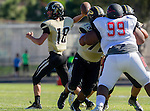 Palos Verdes, CA 09/25/15 - Daniel Schubert (Peninsula #18), Gabor Nemeth (Peninsula #72) and Deon Joshua (Lawndale #99) in action during the Lawndale - Palos Verdes Peninsula Varsity football game at Peninsula High School.