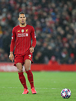 11th March 2020; Anfield, Liverpool, Merseyside, England; UEFA Champions League, Liverpool versus Atletico Madrid;  Virgil van Dijk of Liverpool passes the ball into midfield