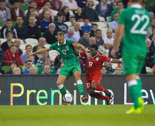 03.09.2014. Dublin, Ireland.  International friendly fixture Republic of Ireland versus Oman. David Meyler (Ireland) battles with Ahmed Al Muhaijri (Oman). Ireland won the match by the score of 2-0