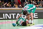 Stockholm 2014-12-03 Handboll Elitserien Hammarby IF - IFK Sk&ouml;vde :  <br /> Hammarbys Johan Nilsson har skadat sig under matchen mellan Hammarby IF och IFK Sk&ouml;vde och tittas till av Nils Pettersson <br /> (Foto: Kenta J&ouml;nsson) Nyckelord:  Eriksdalshallen Hammarby HIF Bajen IFK Lugi skada skadan ont sm&auml;rta injury pain