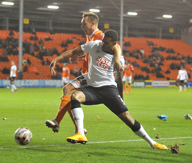 Blackpool's Anthony McMahon and Derby County's Cyrus Christie battle for the ball<br /> <br /> Photographer Dave Howarth/CameraSport<br /> <br /> Football - The Football League Sky Bet Championship - Blackpool v Derby County - Tuesday 21st October 2014 - Bloomfield Road - Blackpool<br /> <br /> &copy; CameraSport - 43 Linden Ave. Countesthorpe. Leicester. England. LE8 5PG - Tel: +44 (0) 116 277 4147 - admin@camerasport.com - www.camerasport.com