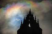 Picture shows today's solar eclipse as seen above the Wallace Monument in Central Scotland at 9.33am - the UK and northern Europe have glimpsed the best solar eclipse since 1999 when the area was plunged into darkness as the Moon came between the Earth and the Sun. The deep shadow formed first in the North Atlantic and then swept up into the Arctic, ending at the North Pole. In all parts of the UK the eclipse reached at least 83% and the darkness peaked at about 09:35 GMT. Clear viewing opportunities were restricted by the cloud cover that shrouded much of the country, which will not see a solar eclipse on this scale again until 2026. The National Wallace Monument - known as the Wallace Monument - stands on the summit of Abbey Craig, a hilltop at near Stirling in Scotland. It commemorates Sir William Wallace, a 13th-century Scottish hero. Completed in 1869 to the designs of architect John Thomas Rochead, the monument is a 67-metre (220ft) sandstone tower, built in the Victorian Gothic style on a spot where from where Wallace was said to have watched the gathering of the army of King Edward I of England, just before the Battle of Stirling Bridge - picture by Donald MacLeod 20.3.15 clanmacleod@btinternet.com www.donald-macleod.com all rights reserved - 07702 319 738