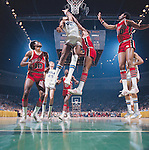 29 MAR 1975:  UCLA forward Marques Johnson (54) and Louisville center William Bunton (33) during the NCAA Men's National Basketball Final Four semifinal game held in San Diego, CA, at the Sports Arena. UCLA defeated Louisville 75-74 in over time to meet Kentucky for the championship. Also pictured Louisville guard/forward Junior Bridgeman (10), UCLA guard/forward Pete Trgovich (25) Louisville forward Allen Murphy (20) and forward Ike Whitfield (40). Photo by Rich Clarkson/NCAA Photos.SI CD 2017-38