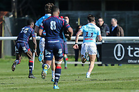 Dean Adamson of Bedford Blues (right) breaks through to score his team's 3rd try of the game during the Greene King IPA Championship match between London Scottish Football Club and Bedford Blues at Richmond Athletic Ground, Richmond, United Kingdom on 25 March 2017. Photo by David Horn / PRiME Media Images.