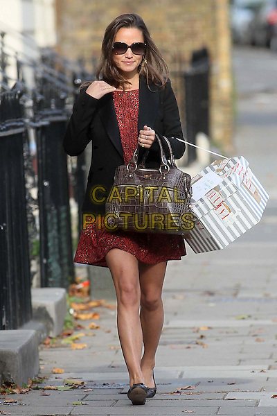 Pippa Middleton spotted in Notting Hill, London, England..October 6th, 2011.full length sunglasses shades red dress blazer black print brown bag purse box shopping.CAP/HIL.©John Hillcoat/Capital Pictures.