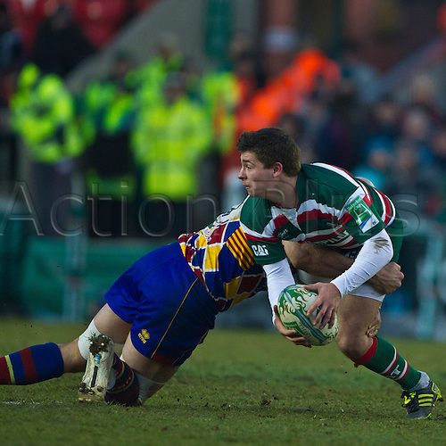 Ben Youngs attempts to pass as he is tackled by Olivier Olibeau.  Leicester Tigers v USA Perpignan in the Heineken Cup at Welford Road, 19th December 2010.  Final score: Leicester 22-22 Perpignan.