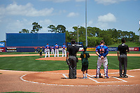 General view of the St. Lucie Mets, including Jhoan Urena (13), Scarlyn Reyes (38), Kevin Taylor (12),  Lednier Ricardo (15), umpires Mike Savakinas (left) and Reid Joyner (right) on the field for the national anthem before a game against the Brevard County Manatees on April 17, 2016 at Tradition Field in Port St. Lucie, Florida.  Brevard County defeated St. Lucie 13-0.  (Mike Janes/Four Seam Images)