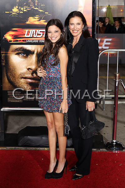 "LUCY JULIA ROGERS-CIAFFA, MIMI ROGERS. Twentieth Century Fox world premiere of Tony Scott's action-thriller, ""Unstoppable,"" at the Regency Village Theater in Westwood. Los Angeles, CA, USA. October 26, 2010. ©CelphImage"