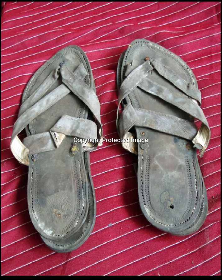 BNPS.co.uk (01202) 558833.Picture: collect..A pair of Gandhi's sandals from the 1920s that were given by the great holy man to a friend are now being sold for £15,000. His size 8 sandals footwear comes with a half-inch heel, which would have boosted the diminutive peace activist to 5ft 5ins...the sandals will be part of a £250,000 archive of material relating to the Indian hero. Many of the items were given to a close friend in 1924 when Gandhi lived at Palm Bun at Juhu in Maharashtra, India, and the artefacts have passed down the family, including a shawl, hand-woven by thread that Gandhi spun himself, his bedsheet, prayer beads and photographs. There are also three of Gandhi's delicately carved miniature figures depicting the wise monkeys; speak no evil, hear no evil, see no evil.