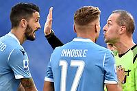 Referee Luca Pairetto argues with Luis Alberto and Ciro Immobile of SS Lazio <br /> Roma 29-9-2019 Stadio Olimpico <br /> Football Serie A 2019/2020 <br /> SS Lazio - Genoa CFC <br /> Foto Andrea Staccioli / Insidefoto