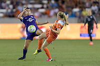 Stephanie Catley (7) of the Orlando Pride and Kealia Ohai (7) of the Houston Dash both attempt to control a loose ball on Friday, May 20, 2016 at BBVA Compass Stadium in Houston Texas. The Orlando Pride defeated the Houston Dash 1-0.